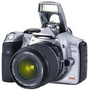 Продам фотоаппарат Canon Eos 350 D + бустер Bg E-3 +много чего